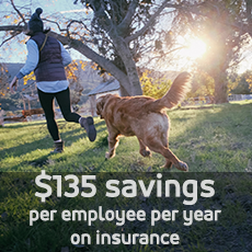 Woman running with dog. Insurance costs $135 less per year for UM System employees than our higher education peers.