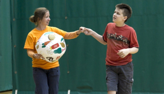 April Regester assists Joshua during camp