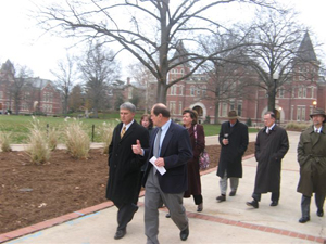 Sen. Rob Mayer, left, visits with MU College of Engineering Dean Jim Thompson as MU Chancellor Brady Deaton and other tour participants cross Francis Quadrangle.