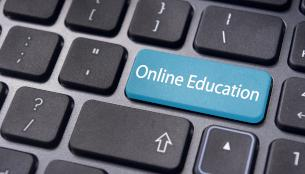"Black keyboard with blue key labeled ""Online Education"""